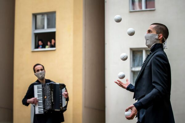 Acrobats Entertain Prague Residents Quarantined Due To Coronavirus