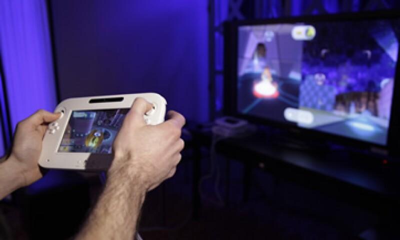 Wii U se venderá como un paquete con un controlador de pantalla táctil, que es casi tan grande como la propia consola. (Foto: AP)