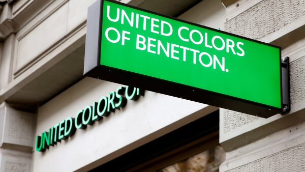 FILE PHOTO: The logo of Italian fashion group Benetton is seen at a store in Zurich