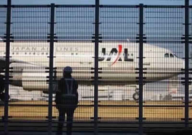 Japan Airlines enfrenta pasivos por 25,600 millones de dólares. (Foto: AP)