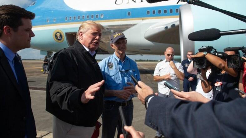 Donald Trump y el gobernador Rick Scott