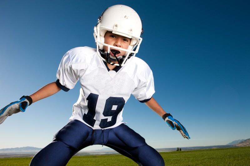 Little League Football Player Ready to Tackle