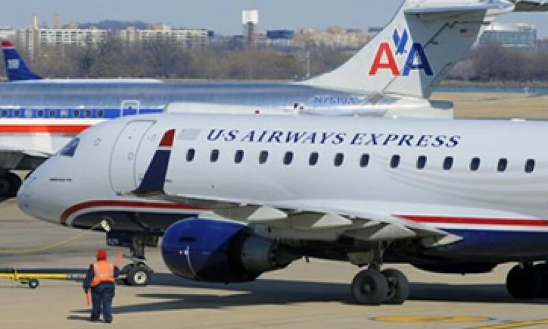 El fiscal general de Texas abandonó la demanda contra American Airlines y US Airways. (Foto: AP)