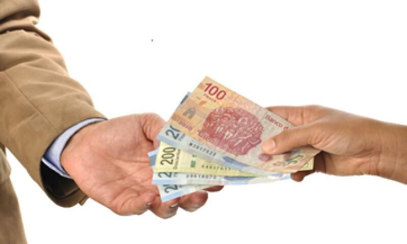 En ventanilla, el dólar se ubica en 14.50 pesos a la venta y 13.80 pesos a la compra. (Foto: iStock by Getty Images. )