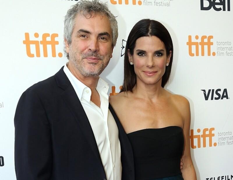 Alfonso Cuarón junto con su musa Sandra Bullock