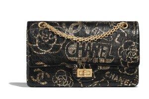 03_A37586_B00979_N0784_Golden_and_black_printed_leather_bag.jpg