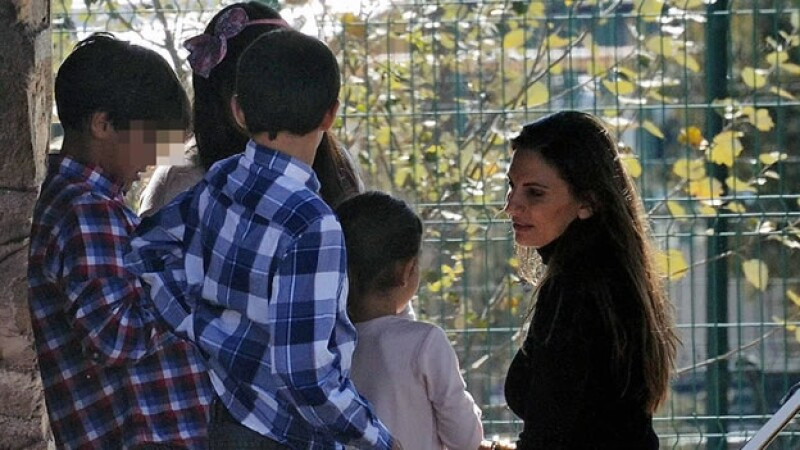 versini con sus hijos