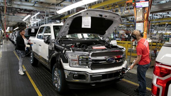 A 2018 F150 pick-up truck moves down the assembly line at Ford's Dearborn Truck Plant during the 100-year celebration of the Ford River Rouge Complex in Dearborn