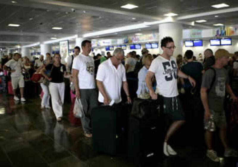 Asur opera nueve aeropuertos en el sureste de México, entre ellos el de Cancún. (Foto: AP)