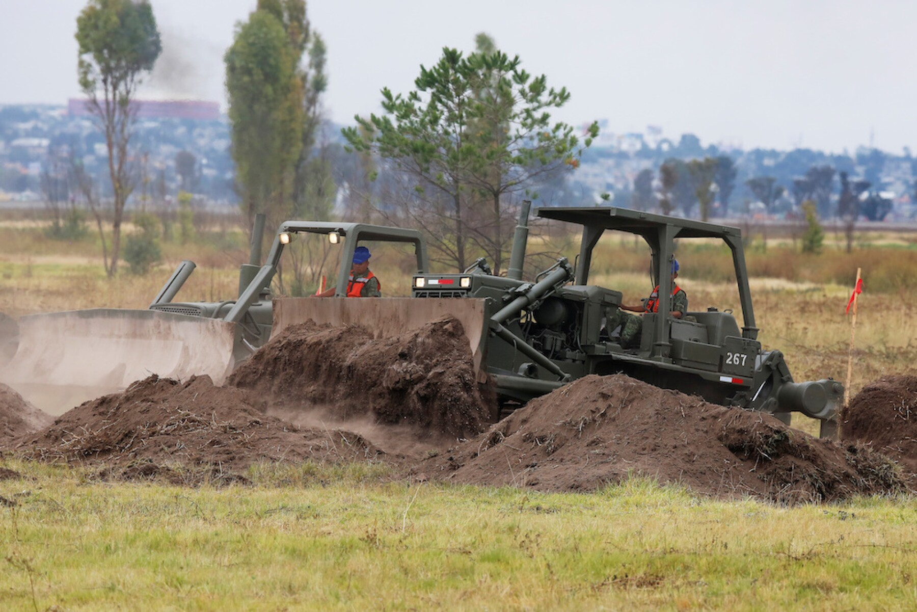 Heavy machinery is pictured working after an official event to mark the beginning of the construction of a new international airport, at the Santa Lucia military airbase in Zumpango