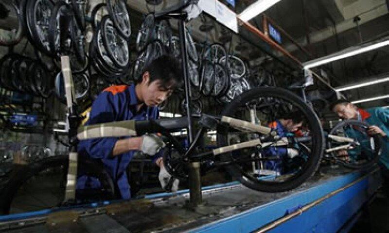 La producción industrial china cayó a 12.4% en noviembre. (Foto: AP)