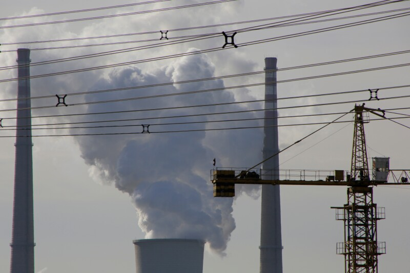 FILE PHOTO: A coal-fired power plant is pictured near a construction site in Beijing