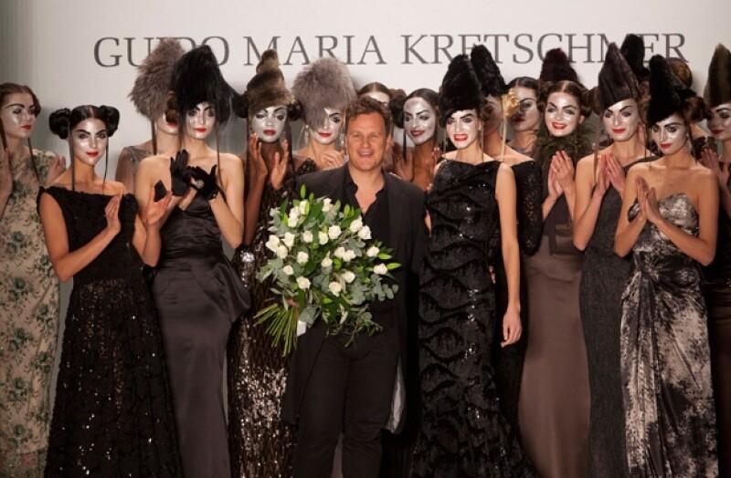 El diseñador Guido Maria Kretschmer y sus modelos.