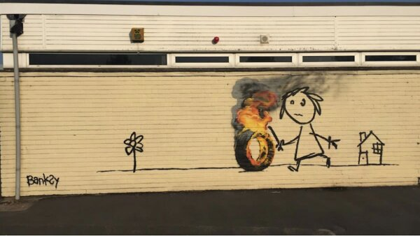 """Banksy les dijo a los alumnos que si no les gusta su mural, """"no duden en añadir cosas""""."""