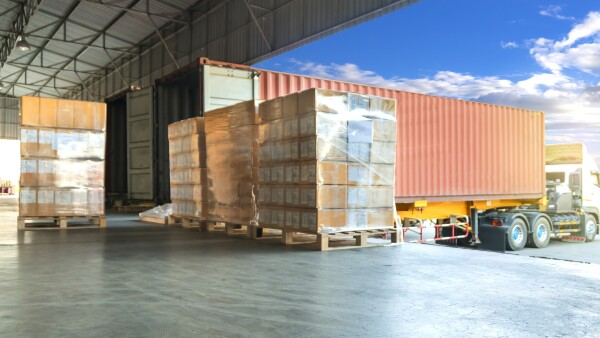 Warehouse and Logistics transportation, stack of cardboard boxes or cargo shipment on pallet for loading into a truck