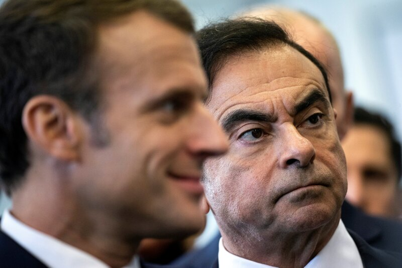 FILE PHOTO: French President Emmanuel Macron and Renault CEO Carlos Ghosn visit the Renault factory in Maubeuge