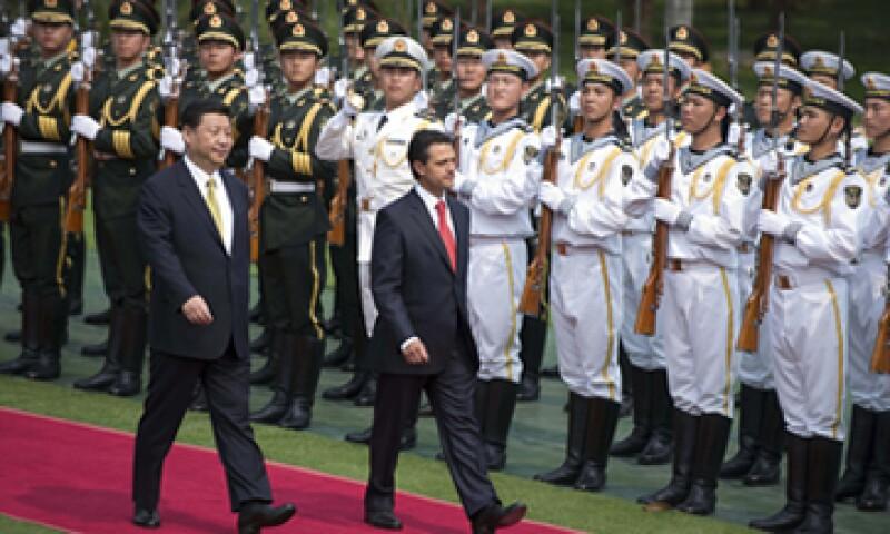 El presidente Peña Nieto tuvo su primer encuentro oficial con su homólogo chino, Xi Jinping (izquierda).(Foto: AP)