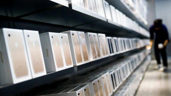 FILE PHOTO - Apple's new iPhone 7 smartphones sit on a shelf at an Apple store in Beijing, China