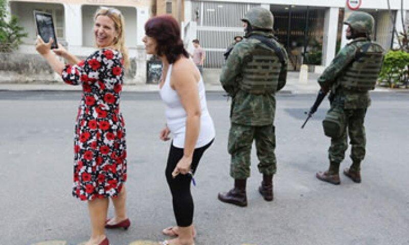 Los turistas tendrán el apoyo de policías y militares en las calles cariocas. (Foto: Getty Images)