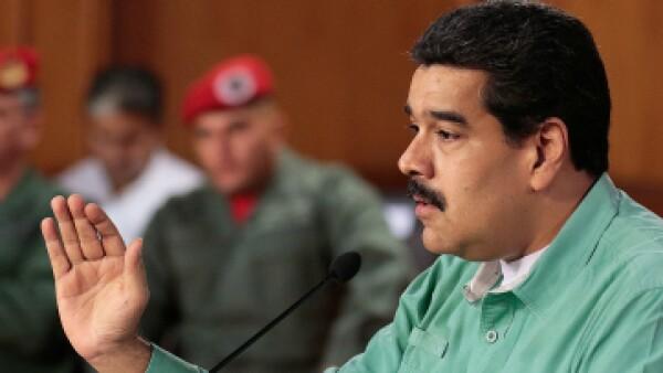 El líder socialista ratificó al ministro del petróleo. (Foto: AFP/ Presidencia)