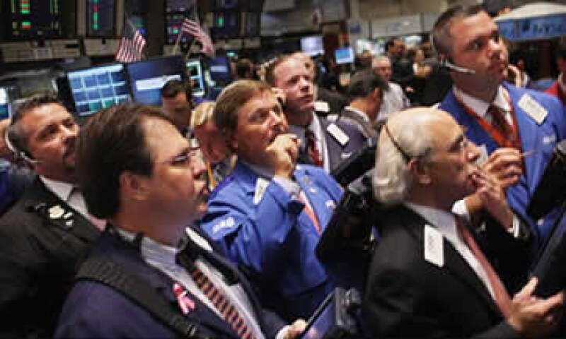 Los inversores esperan una respuesta fuerte de Alemania y Francia para frenar la crisis de deuda en la zona euro. (Foto: Cortesía CNNMoney)