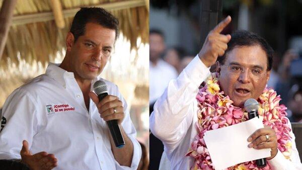 Alejandro Murat (izquierda) de la coalición PRI-PVEm-Panal y Benjamín Robles Montoya del Partido del Trabajo (derecha).