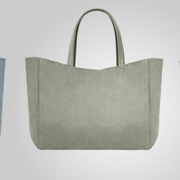 Una opción de bolsa, en tres diferentes colores, fabricada en piel.