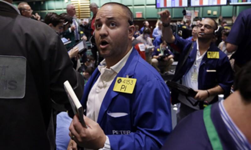 La Fed compra actualmente 85,000 millones de dólares al mes en bonos para alentar la recuperación económica. (Foto: Archivo)