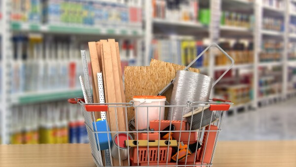 construction tools and materials inside  a shopping basket. 3d illustration