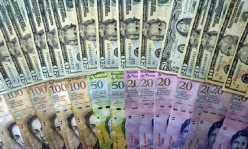 El tipo de cambio Sicad está dirigido a las importaciones no prioritarias y a actividades turísticas.  (Foto: AFP )