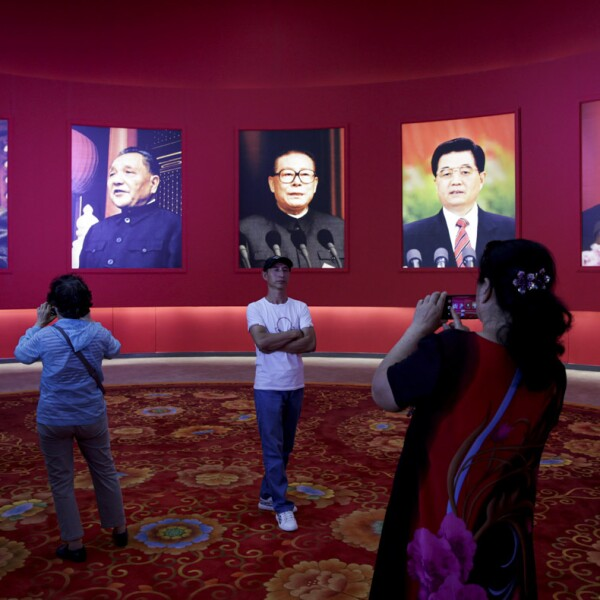 Visitor poses during an exhibition on China's achievements marking the 70th anniversary of its founding at the Beijing Exhibition Center
