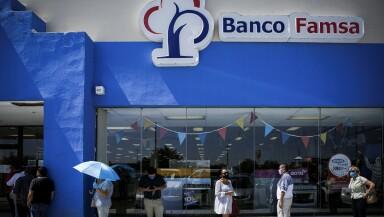 People queue to enter to a branch of Banco Ahorro Famsa, the savings bank arm of retailer Grupo Famsa, in Ciudad Juarez