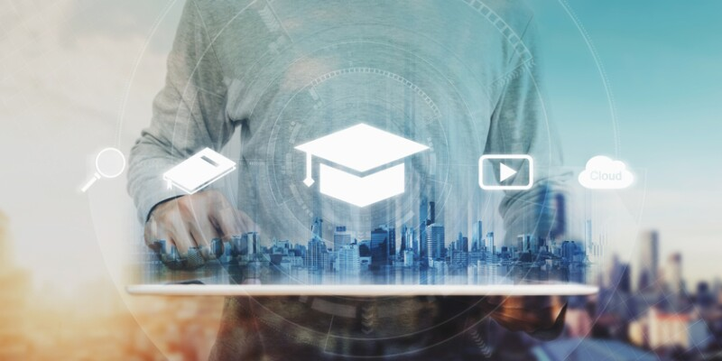 Online education, e-learning and e-book concept. a man using digital tablet for education, with education and online learning media icons