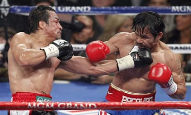 La promotora de Pacquiao se apuró a ofrecer la revancha a Márquez, quien aceptaría una cuarta pelea con el rival filipino. (Foto: AP)