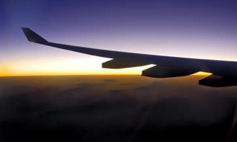Delta Air Lines y US Airways Group no vislumbran señal alguna de que la demanda de viajes disminuya. (Foto: Photos to Go)