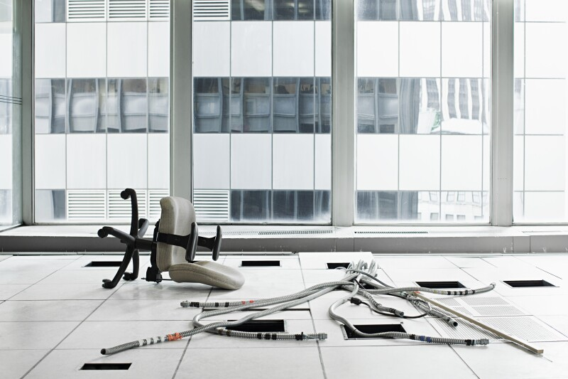 Office chair and cables on floor