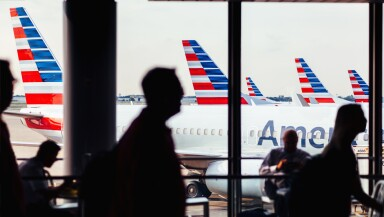 American Airlines fleet of airplanes with passengers at O'Hare Airport