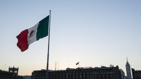 Mexican flag at sunset