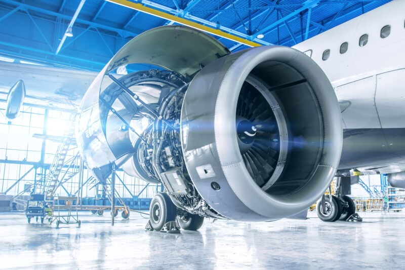 Industrial theme view. Repair and maintenance of aircraft engine on the wing of the aircraft.