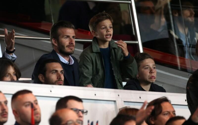David y sus tres hijos disfrutaron del partido.