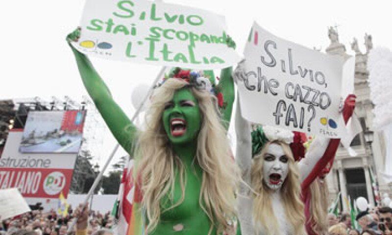 Integrantes del grupo Femen, procedentes de Ucrania, mostraron sus pechos como parte de la protesta. (Foto: Reuters)