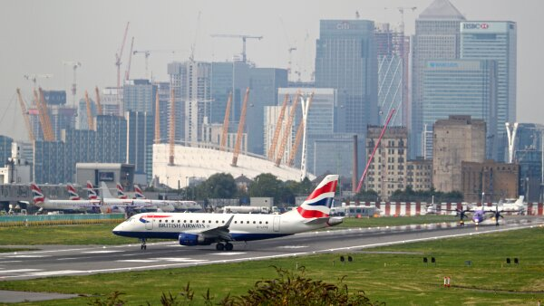 A British Airways airplane taxis at City Airport in London