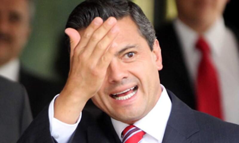 Después de una hora con 45 minutos que duró el encuentro, Peña Nieto se retiró del Auditorio de la Universidad Iberoamericana. (Foto: Notimex)