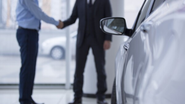 Handshaking in a car showroom