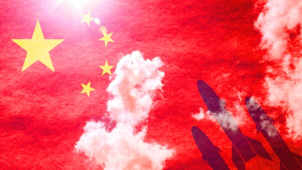 Missiles in front of sunny chinese flag