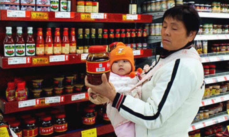 El principal riesgo macro de China es transitar rápidamente de la inflación al crecimiento, dice Qu Hongbin, de HSBC. (Foto: Cortesía CNNMoney)