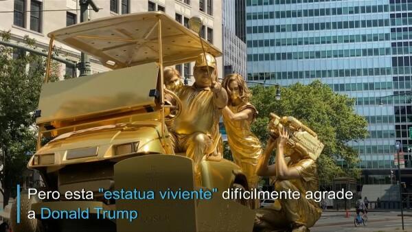 Un Trump de oro sobre víctimas de COVID-19, la estatua que crítica al presidente