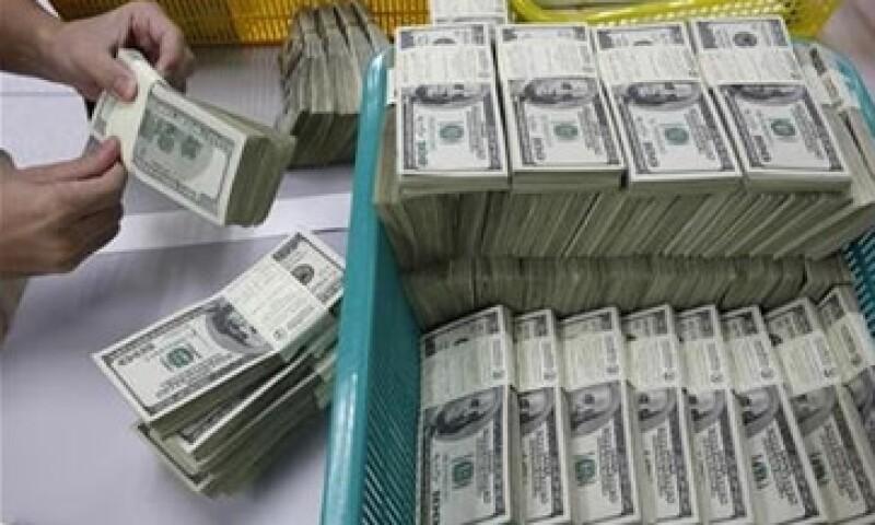 El Banco de México fijó el tipo de cambio en 12.9902 pesos para solventar obligaciones denominadas en moneda extranjera. (Foto: Reuters)