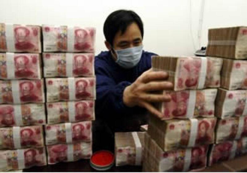 Los bancos chinos emitieron un total de 17.5 billones de yuanes en nuevos préstamos en moneda local en el 2009 y 2010. (Foto: Reuters)