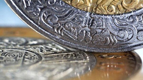 macro of mexican coins with a selective focus